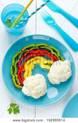Colorful pepper cauliflower rainbow vegetarian snack food art idea
