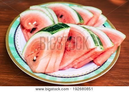 Slices of watermelon on a wooden table. Top view