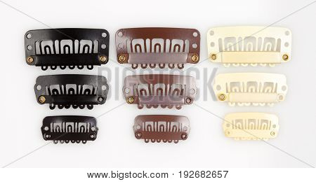 Set of Women's Plastic Hair Clips Isolated on White