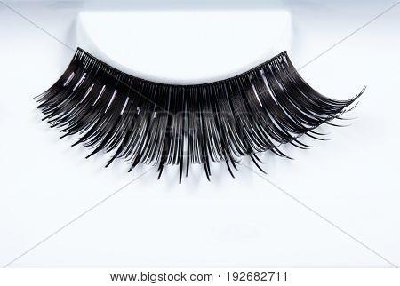 Extreme Closeup of Artificial Long Black Eyelashes