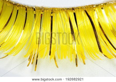 Extreme Closeup of Artificial Long Yellow Eyelashes