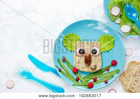 Koala sandwich - creative idea for kids lunch fun animal sandwich shaped koala with bread vegetable fruit berry