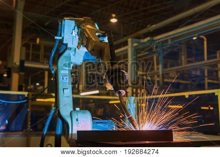 Robot welding assembly car part in factory