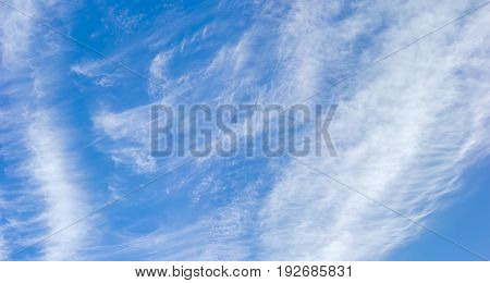 Background of a panoramic view of a fragment of the sky with cirrus clouds in summer day