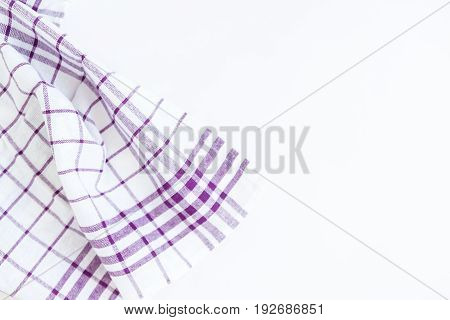 Magenta purple cloth kitchen towel with checkered pattern isolated on white background isolated.