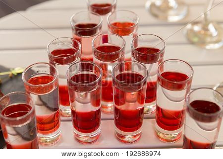 Variation Of Hard Alcoholic Shots Served On On White Table