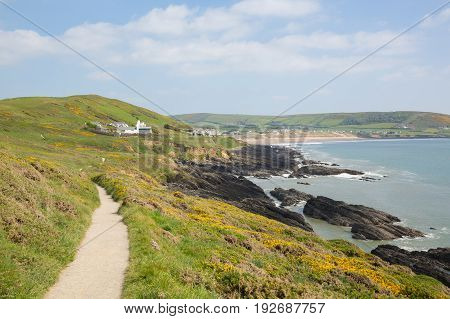 Coast path to Croyde Devon from Woolacombe in summer with blue sky