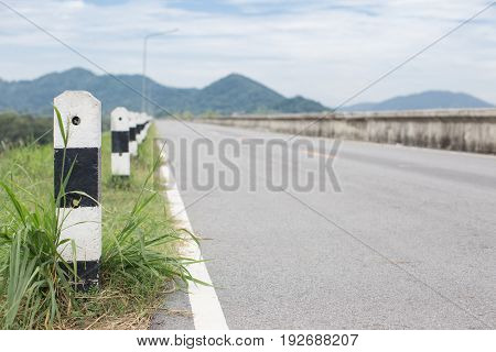 Asphalt road lining with mountain background in Thailand.