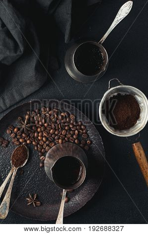 Old Coffee Pot And Coffee Beans Over Dark Concrete Background
