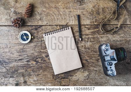 Retro Camera And Compass On A Wooden Background. Travel Concept