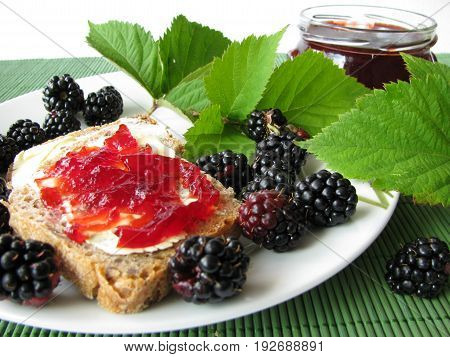 Breakfast with fresh blackberries and blackberry jelly