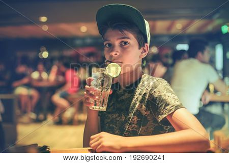 Thirsty boy drinking a refreshing drink