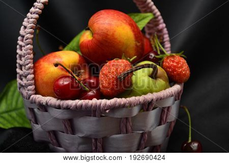 basket with fruits and berries, the taste of summer
