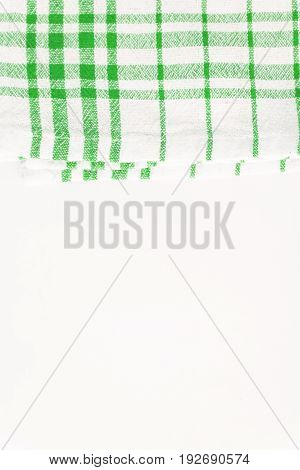Green cloth, a kitchen towel with a checkered pattern, on a white background isolated.