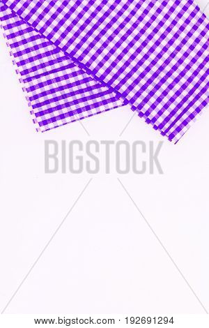 Magenta, purple cloth, kitchen towel with checkered pattern, isolated on white background isolated.