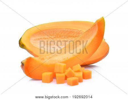 half adn slice of fresh papaya with cubes isolated on white background