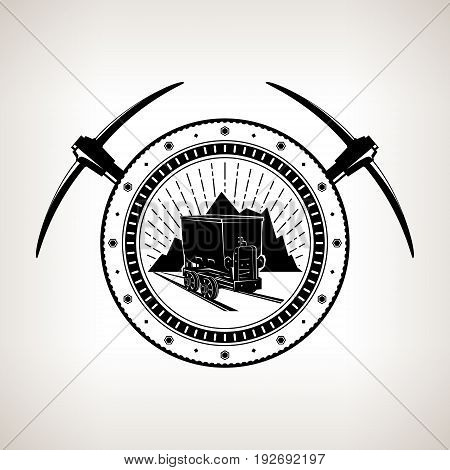 Vintage Emblem of the Mining Industry Coal Mine Trolley against Mountains and Sunburst in a Gear with Two Crossed Pickaxes Label and Badge Mine Shaft Vector Illustration