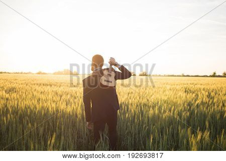 Happy manager with ukulele travel in summer wheat fields, buisinesman in suit play on ukulele, vacation or travel concept photo