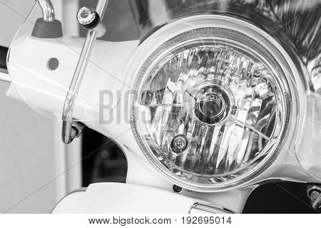 Scooter or Motorcycle headlight lamp with lamp light turned off and windshields for transportation or technology concept design. Black and white.