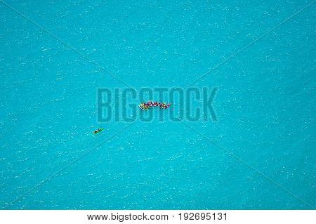 Colorful kayaks on the tropical beach on Milos island, Greece