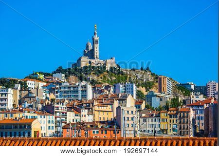 Marseilles in May. The water area of the Old Port. On the hill - splendid Basilica of Notre-Dame de la Garde