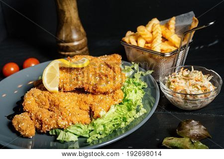 Delicious Mouth Watering Schnitzel Served With French Fries At Local Restaurant