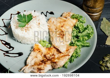 Close Up Details Of Grilled Chicken Breast With Risotto And Parsley