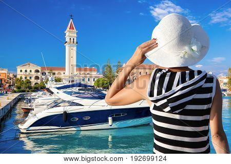 Woman With Hat Watching Marina With Boats In Zakynthos Town, Greece