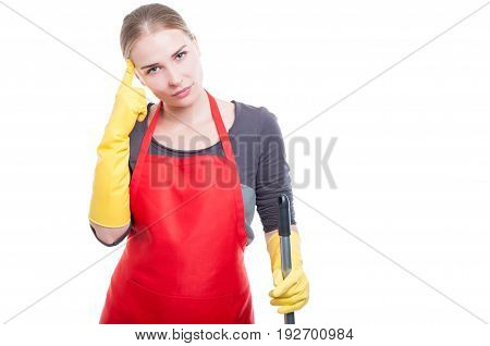 Housekeeper Thinking At Something And Holding A Broom