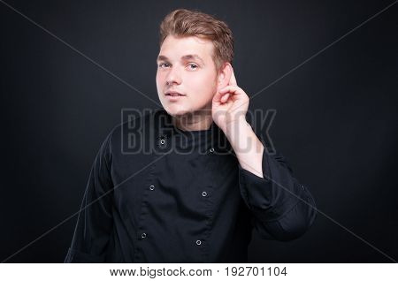 Attractive Cook Paying Attention On News