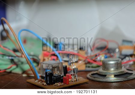 Parts of electrical engineering - electrical resistors diodes capacitor speakers - close-up