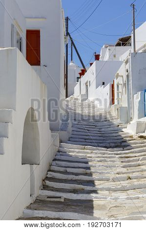 Street with typical Cycladic architecture in Apollonia village on Sifnos island in Greece.
