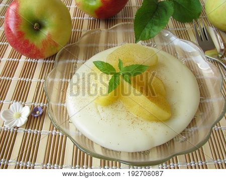 Homemade gluten free dessert with blancmange from maize starch and stewed apples