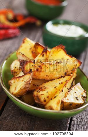 Spicy roasted potato wedges with mayonnaise and ketchup