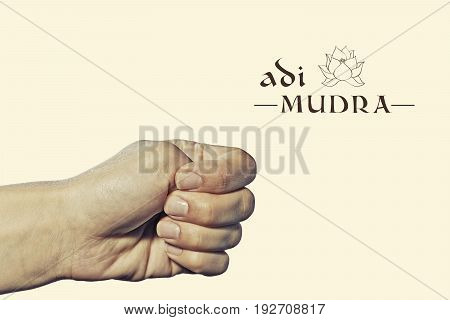 Adi mudra. Yogic hand gesture. Isolated on toned background.