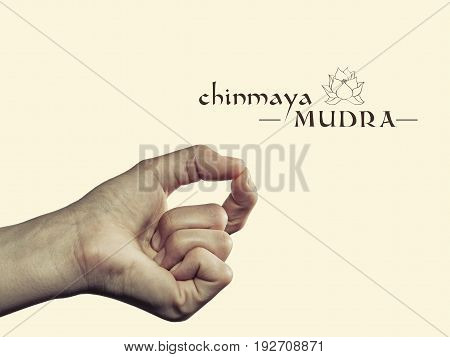 Chinmaya mudra. Yogic hand gesture. Isolated on toned background.