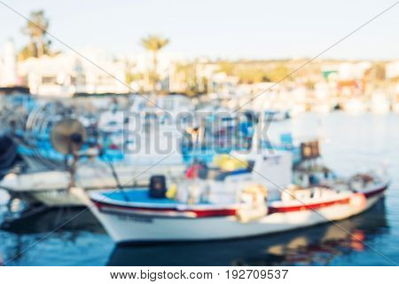 Blurred background. Yachts in the port Boat harbor.