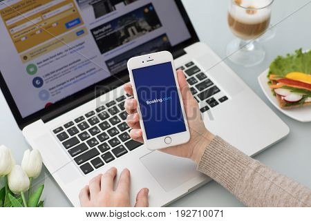Alushta Russia - May 26 2017: iPhone with app Booking.com online hotel reservations on the screen. iPhone was created and developed by the Apple inc.