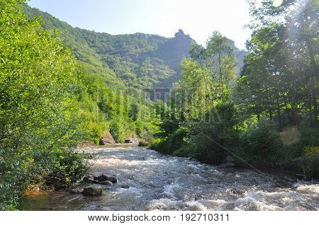 Beautiful view on mountain river under a Old Mountain, Serbia. Wild river with a lot of cascade. Mountain river with a fresh and clean water.