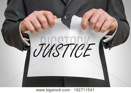 Businessman Tearing Paper With Justice Word