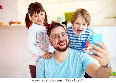 Making Selfie Snap Shot With Crazy Hairstyle And Makeup When You Home Alone With Children