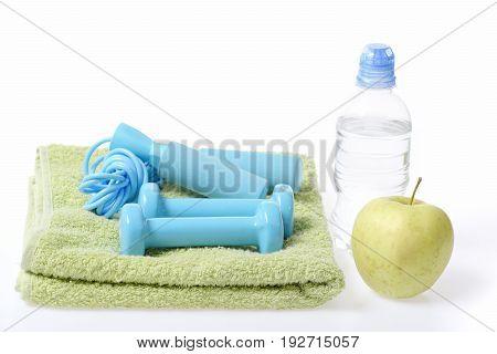Gym Time: Cyan Blue Barbells And Skipping Rope On Towel