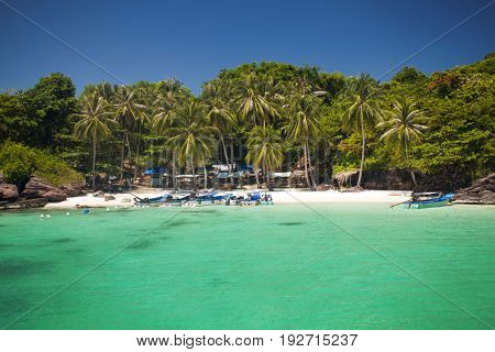 PHU QUOC, VIETNAM - March 22, 2017: Remote tropical island with palm trees and blue ocean near Phu Quoc, Vietnam