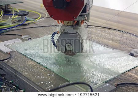 Cutting patterns on the glass plate by CNC machine