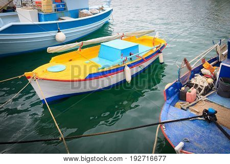 Colorful Greek fishing boats in port of Kardamena in Kos island Greece.