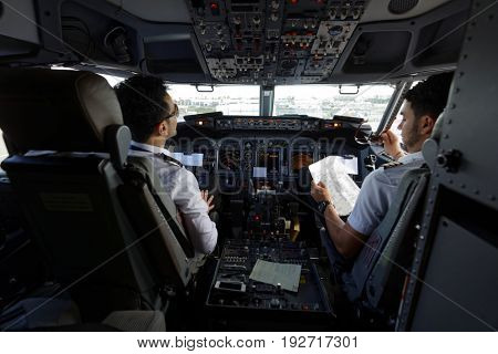 FARO, PORTUGAL - MAY 13, 2017: Pilots in the cabin of Ryanair aircraft. Ryanair has an unblemished 32-year safety record