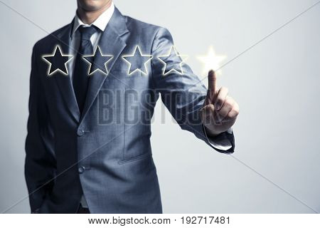 Businessman is give star rating business background level business service and product.