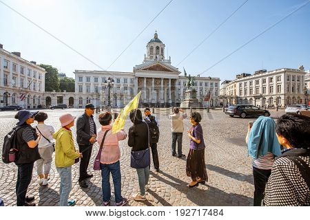 BRUSSELS, BELGIUM - June 01, 2017: Asian tourists on the Royal square with church and monument in Brussels
