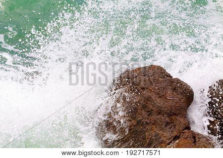 Huge waves crashing against the rocks of Kos island Greece.