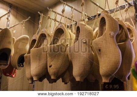 Row of blank new wooden Dutch clogs for sale on a marketMarken The Netherlands